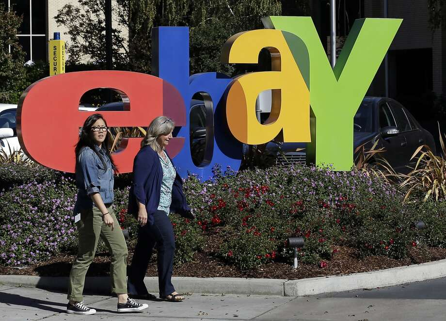 FILE - In this Oct. 17, 2012, file photo, two women walk in front of an eBay sign at the company's headquarters in San Jose, Calif. EBay reports quarterly earnings on Tuesday, April 29, 2014. (AP Photo/Marcio Jose Sanchez, File) Photo: Marcio Jose Sanchez, Associated Press