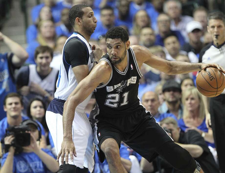 San Antonio Spurs' Tim Duncan drives around Dallas Mavericks' Brandan Wright during the first half of game four in the first round of the Western Conference Playoffs at the American Airlines Center in Dallas, Monday, April 28, 2014. The Mavericks lead the series 2-1. Photo: Jerry Lara, San Antonio Express-News
