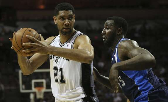 San Antonio Spurs' Tim Duncan drives around Dallas Mavericks' DeJuan Blair during the first half of game two in the first round of the Western Conference Playoffs at the AT&T Center, Wednesday, April 23, 2014. Photo: Jerry Lara, San Antonio Express-News
