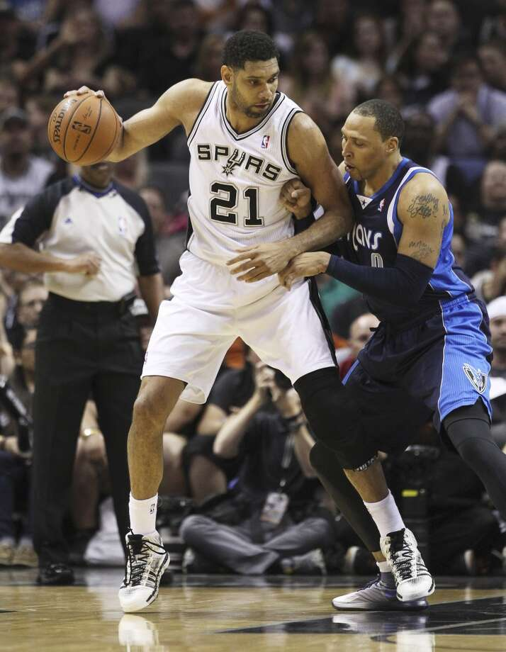 Spurs' Tim Duncan (21) attempts to make a move against Dallas Mavericks' Shawn Marion (00) in the first half of Game 2 of the first round of the Western Conference playoffs at the AT&T Center on Wednesday, April 23, 2014. Photo: Kin Man Hui, San Antonio Express-News