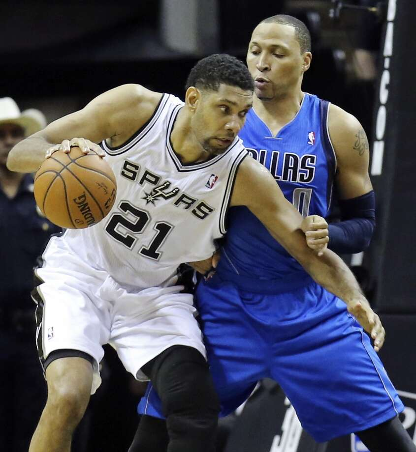 San Antonio Spurs' Tim Duncan looks for room around Dallas Mavericks' Shawn Marion during first half action of Game 1 in the first round of the Western Conference playoffs Sunday April 20, 2014 at the AT&T Center. Photo: Edward A. Ornelas, San Antonio Express-News