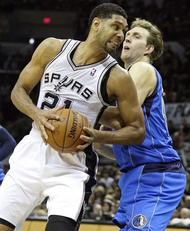 San Antonio Spurs' Tim Duncan looks for room around Dallas Mavericks' Dirk Nowitzki during second half action of Game 1 in the first  round of the Western Conference playoffs Sunday April 20, 2014 at the AT&T Center. The Spurs won 90-85. Photo: Edward A. Ornelas, San Antonio Express-News
