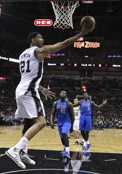San Antonio Spurs' Tim Duncan shoots as Dallas Mavericks' DeJuan Blair and Jae Crowder look on during second half action of Game 1 in the first  round of the Western Conference playoffs Sunday April 20, 2014 at the AT&T Center. The Spurs won 90-85. Photo: Edward A. Ornelas, San Antonio Express-News
