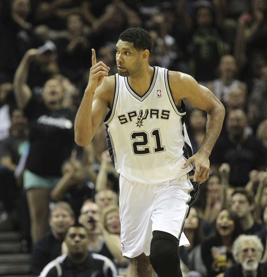 San Antonio Spurs' Tim Duncan reacts after scoring during the second half of game one in the first round of the Western Conference Playoffs against the Dallas Mavericks at the AT&T Center, Sunday, April 20, 2014. The Spurs won 90-85 to best out of seven series 1-0. Photo: Jerry Lara, San Antonio Express-News