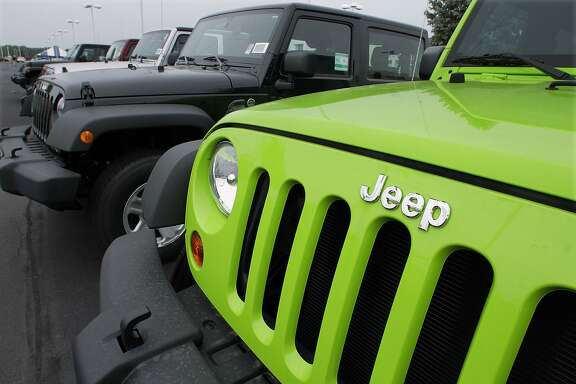 FILE - In this July 1, 2012 file photo, Jeeps sit for sale at a Chrysler dealership in Springfield, Ill. Fiat and Chrysler announced an agreement Saturday, April 19, 2014, that they will build three new Jeep models in China for the local market, the biggest for Jeeps outside the U.S. (AP Photo/Seth Perlman, File)