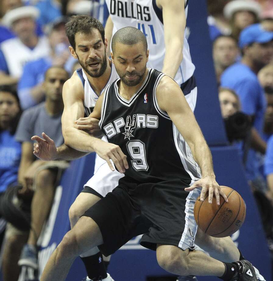 San Antonio Spurs' Tony Parker gets pressure from Dallas Mavericks' Jose Calderon during the first half of game four in the first round of the Western Conference Playoffs at the American Airlines Center in Dallas, Monday, April 28, 2014. The Mavericks lead the series 2-1. Photo: Jerry Lara, San Antonio Express-News