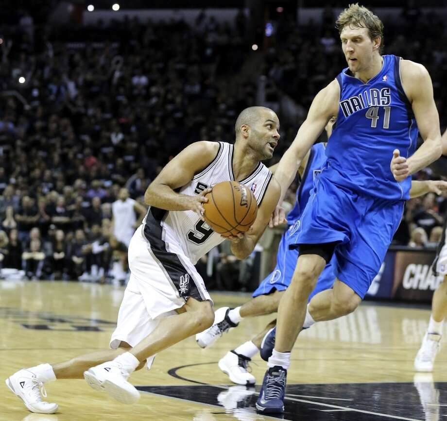 San Antonio Spurs' Tony Parker looks for room around Dallas Mavericks' Dirk Nowitzki during second half action of Game 1 in the first round of the Western Conference playoffs Sunday April 20, 2014 at the AT&T Center. The Spurs won 90-85. Photo: Edward A. Ornelas, San Antonio Express-News