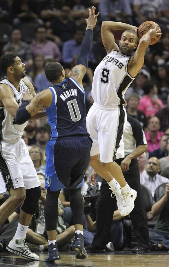 San Antonio Spurs' Tony Parker passes the ball around Dallas Mavericks' Shawn Marion during the second half of game two in the first round of the Western Conference Playoffs at the AT&T Center, Wednesday, April 23, 2014. Photo: Jerry Lara, San Antonio Express-News