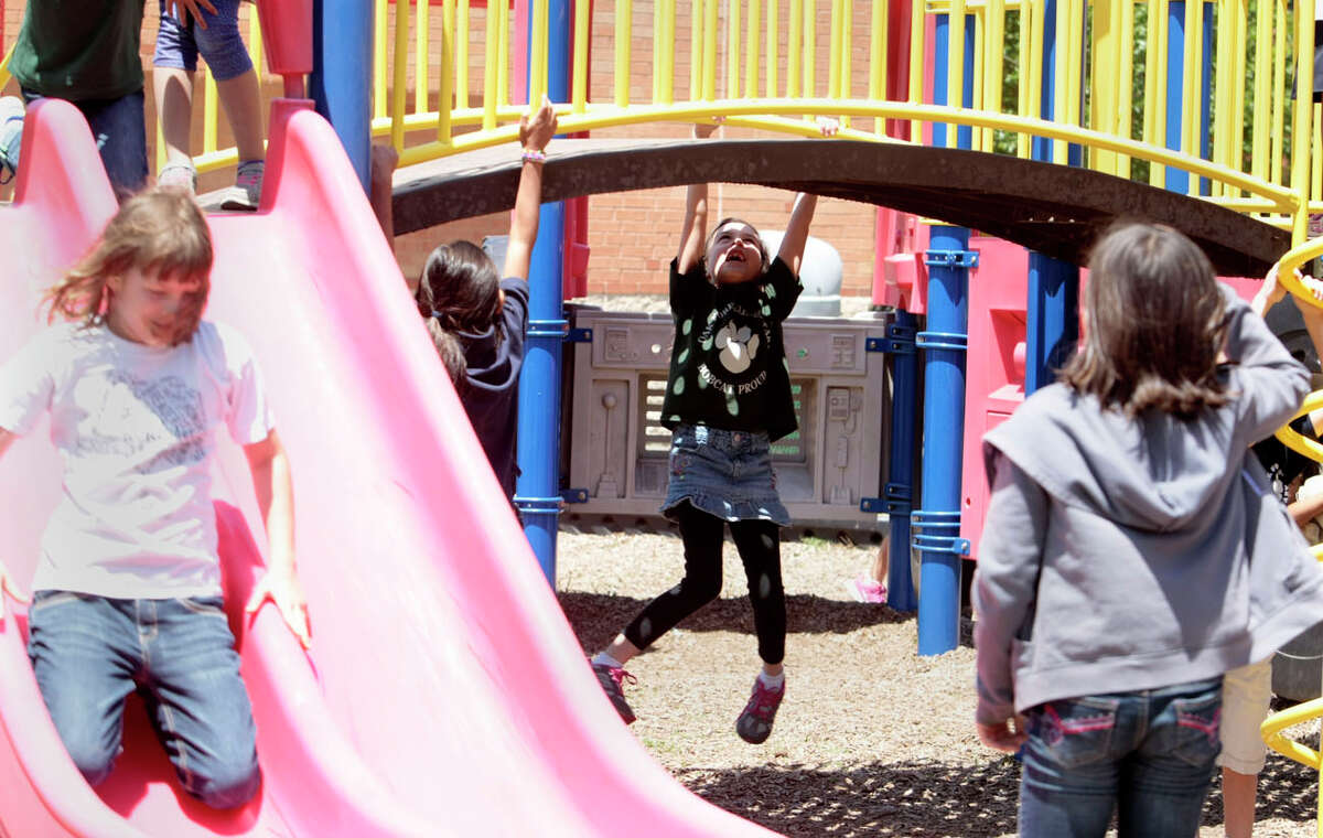 Students at play during recess at Oak Forrest elementary Wednesday April 30, 2014. (Billy Smith II / Houston Chronicle)