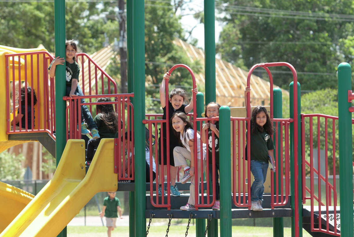 Recess at Oak Forest Elementary School finds the playground busy with children. Oak Forest has seen big increases in its home values.