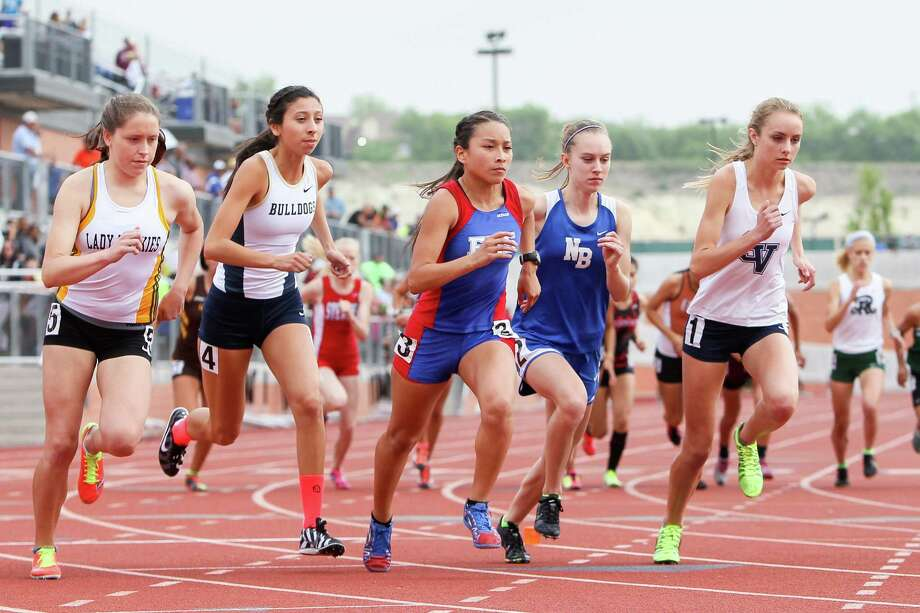 Holmes' Stephanie Barlow (from left), Laredo Alexander's Regekah Hernandez, Edingurg's Alexandria Cruz, New Braunfels' Paige Hofstad and Smithson Valley's Devin Clark take off from the starting line of the 5A 3200-meter run during the Region IV-5A and Region IV-4A track and field meets at Heroes Stadium on Friday, April 25, 2014. Clark won the event with a time of 10 minutes, 27.13 seconds.  Hofstad finished second with 10 minutes, 27.99 seconds and Barlow was third in 10 minutes, 56.21 seconds. MARVIN PFEIFFER/ mpfeiffer@express-news.net Photo: MARVIN PFEIFFER, Marvin Pfeiffer/ Express-News / Express-News 2014