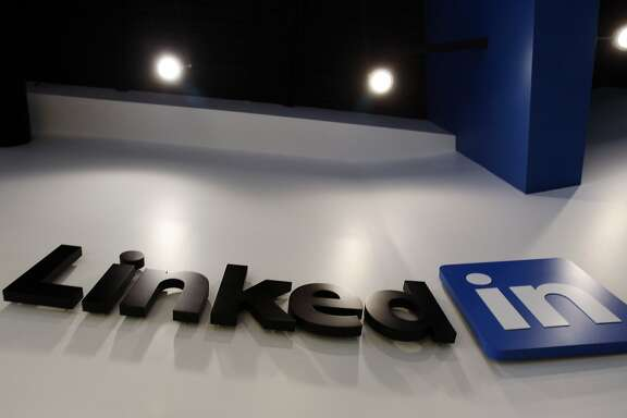 FILE - In this May 19, 2011 file photo,the LinkedIn logo is displayed in the foyer at headquarters in Mountain View, Calif. LinkedIn Corp. reports quarterly earnings on Thursday, Feb. 6, 2014. (AP Photo/Paul Sakuma, File)