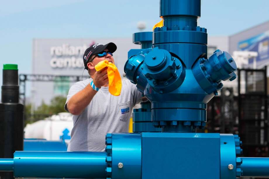 Eric Nielsen of Weir Oil & Gas puts a polish on a Frac tree that is part of a complete well head system. Weir Oil & Gas will have the system on display at the Offshore Technology Conference 2014 at NRG Park, Thursday May 1, 2014 in Houston. OTC 2014 is scheduled for May 5-8. (Billy Smith II / Houston Chronicle) Photo: Billy Smith II, Chronicle