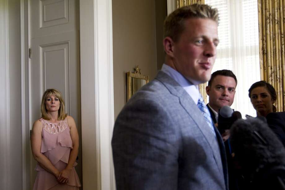 Connie Watt, left, mother of Texans defensive end J.J. Watt watches her son speak following a charity luncheon for Pro Vision Charter School on Thursday. Photo: Brett Coomer, Houston Chronicle