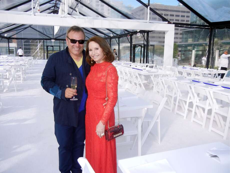Designer Stanlee Gatti and Christine Lamond in his all-white Patrons' Dinner tent.