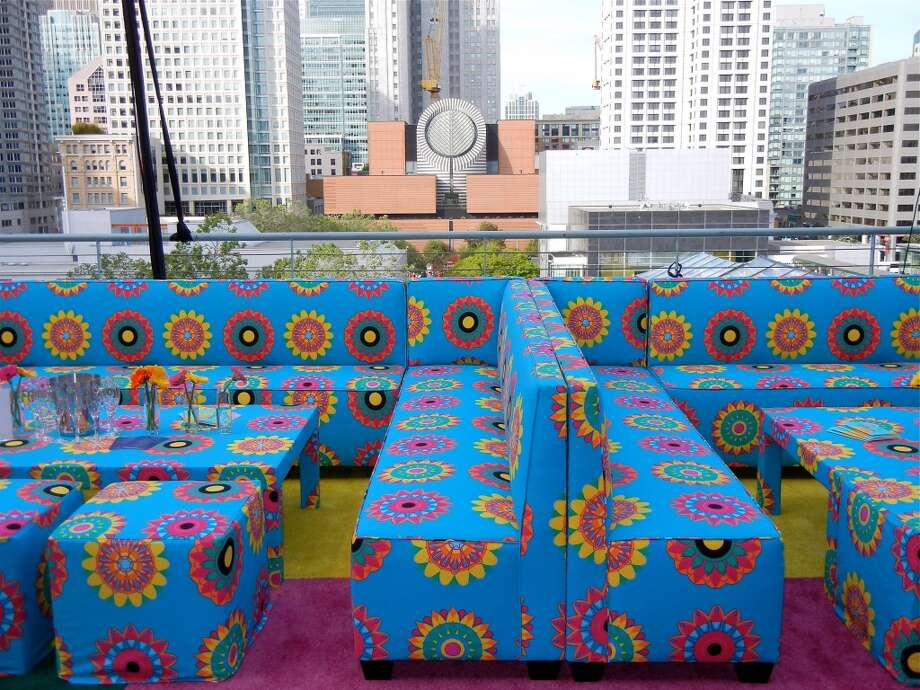 Modish flower-power fabric set a different scene atop banquets at the Supper Club on the balcony of Metreon's City View space.