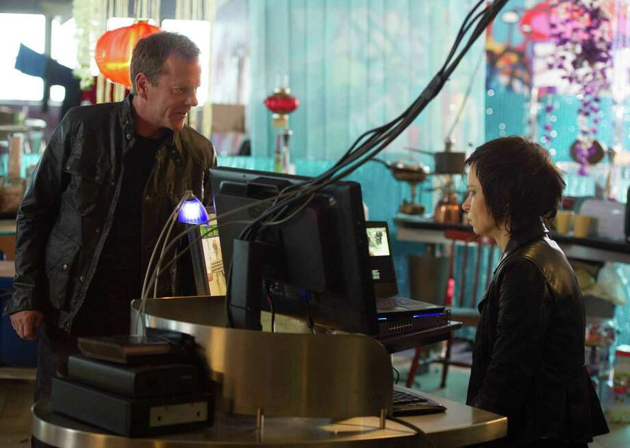"On-the-lam ex-CIA operative Jack Bauer (Kiefer Sutherland) reunites with a hesitant and hardened Chloe (Mary Lynn Rajskub) in the special two-hour season premiere of ""24: Live Another Day."" Photo: Fox / San Antonio Express-News"