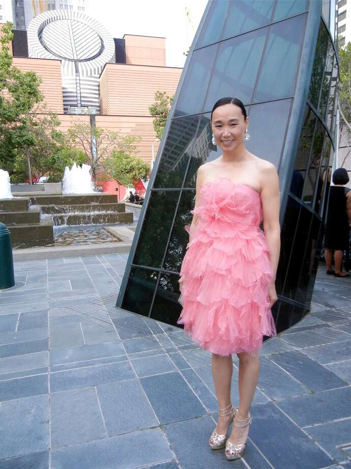Dr. Carolyn Chang in a decidedly modern Oscar de la Renta cocktail dress.