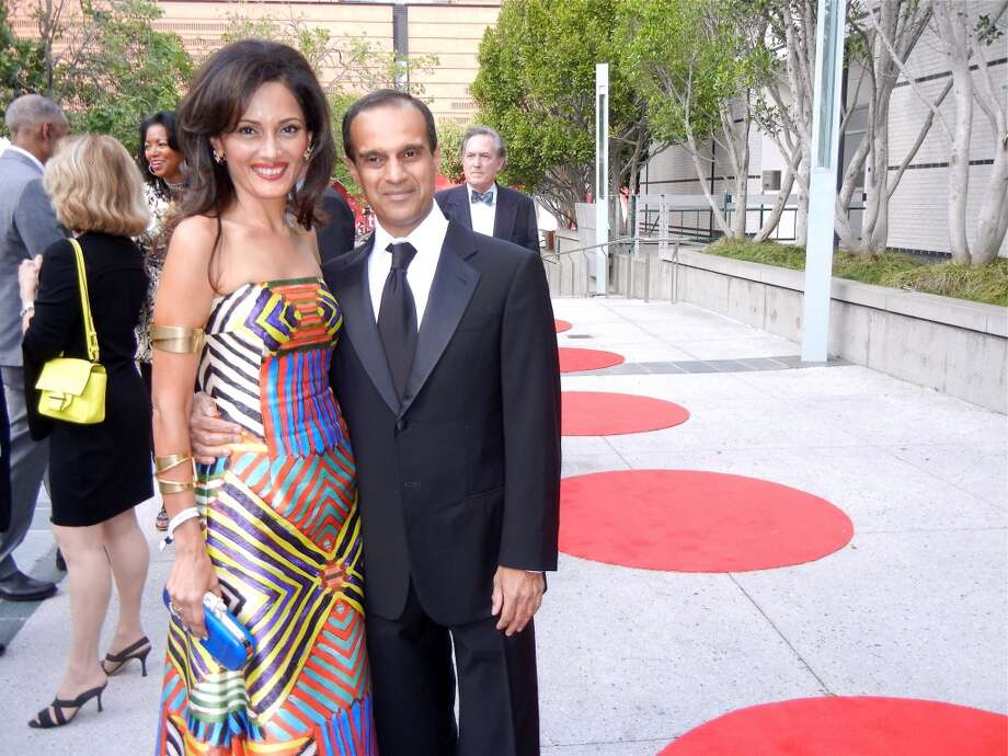 Komal Shah (in a knockout Naeem Khan gown) and her husband, Gaurav Garg.
