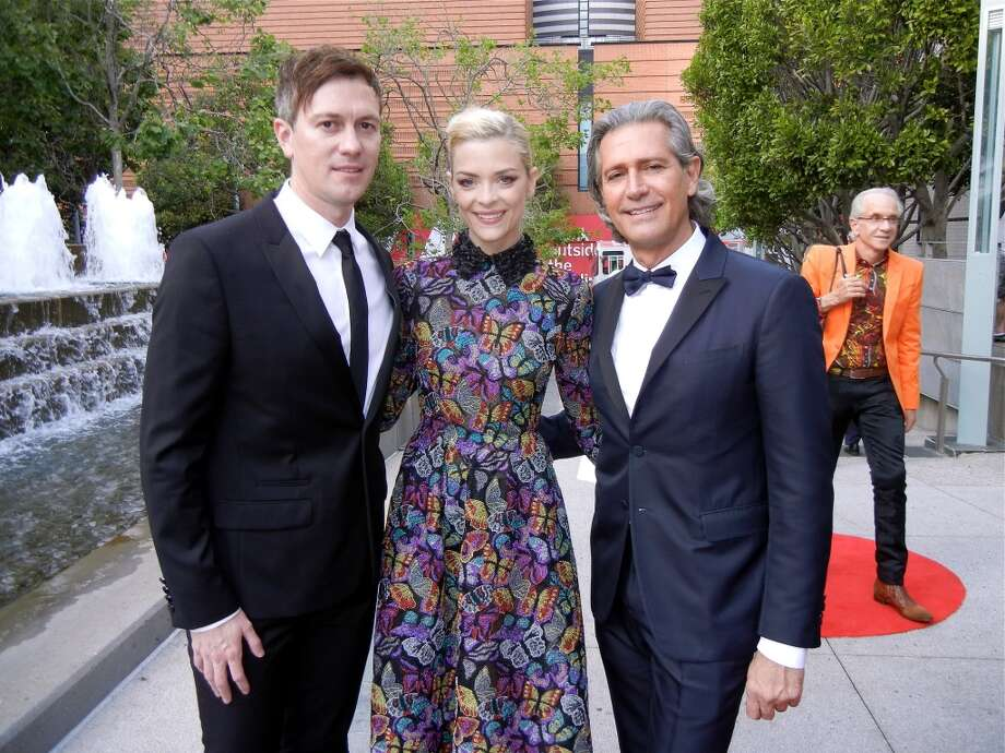 Kyle Newman (left) with his wife, actress Jamie King (in Valentino) and Valentino Ambassador Carlos Souza.