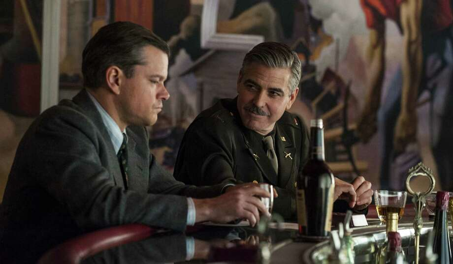 "Matt Damon (left) and George Clooney are among the stars in ""The Monuments Men,"" the Darien Library's Friday Night Feature this week. Find out more.  Photo: Columbia Pictures / Columbia Pictures - Sony"