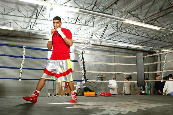 HAYWARD, CA - APRIL 24:  Amir Khan in action during a workout session at Virgil Hunter's Gym on April 24, 2014 in Hayward, California. Kahn is preparing to take on Luis Collaz at the MGM Grand in Las Vegas on May 3, 2014. (Photo by Alexis Cuarezma/Getty Images)