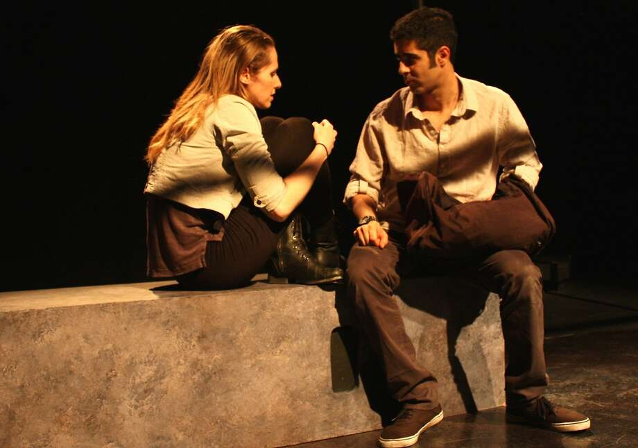 "Marlene (Maura Halloran) tells Hassan (Damien Seperi) that she wants to participate in demonstrations after his brother's killing by the police in the Cutting Ball Theater's ""Communiqué nº 10."" Photo: Laura Mason"