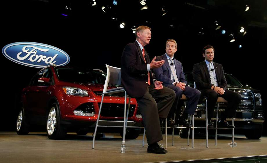 Alan Mulally, chief executive officer of Ford Motor Co., left, takes part in a news conference with William Clay Ford Jr., executive chairman, center, and Mark Fields, the chief operating officer who will become CEO.  Photo: Jeff Kowalsky / © 2014 Bloomberg Finance LP
