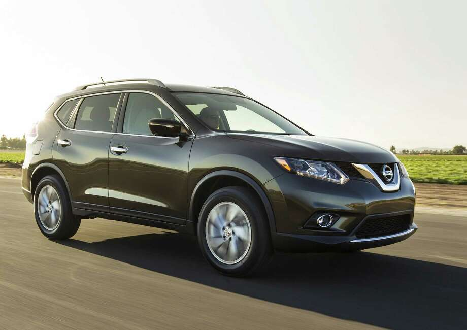 This undated product image provided by Nissan North America shows the 2014 Nissan Rogue small SUV. American car buyers came out of hibernation in April to spend on pickup trucks and SUVs, fueling an auto sales rebound that analysts expect to last the rest of the year. Nissan led the way with an 18.3 percent increase over a year ago, with sales of the redesigned Rogue up almost 27 percent. (AP Photo/Nissan North America) ORG XMIT: NYBZ166 Photo: Uncredited / Nissan North America