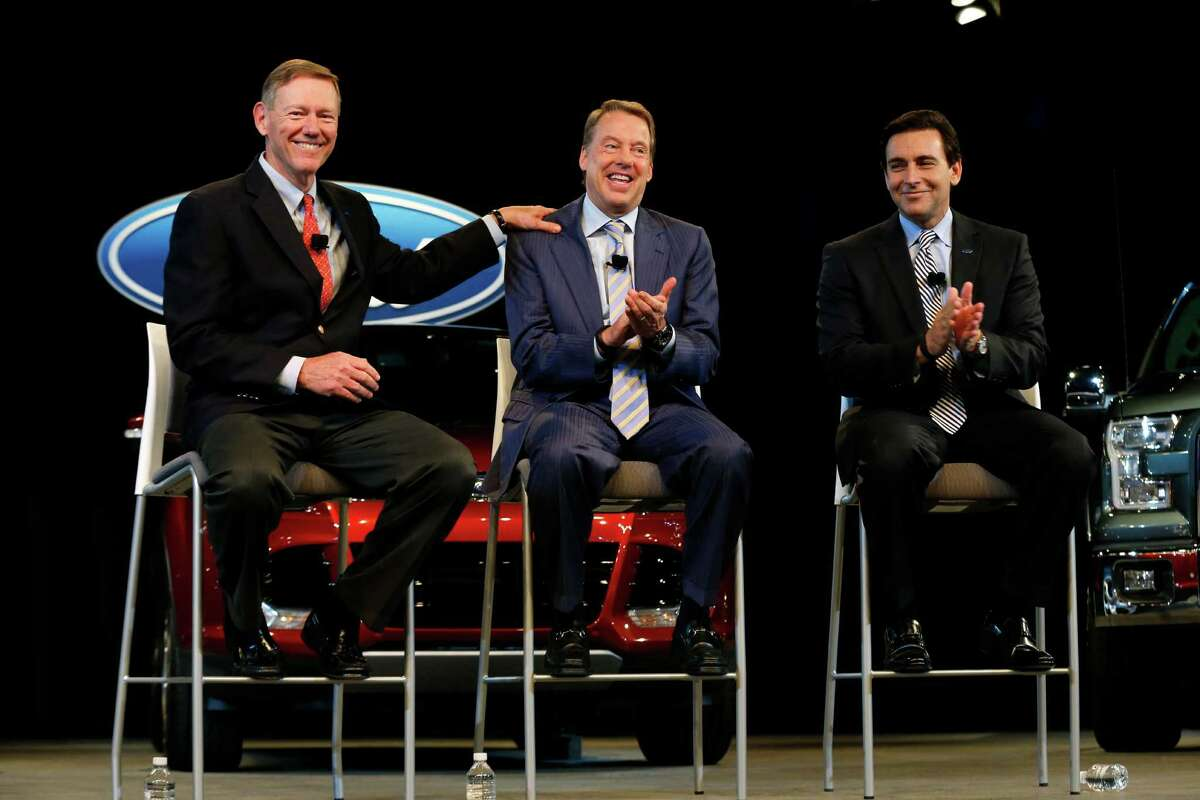 Ford Motor Company President and CEO Alan Mulally, from left, Executive Chairman Bill Ford Jr., and Chief Operating Officer Mark Fields appear during a news conference in Dearborn, Mich., Thursday, May 1, 2014. Ford announced CEO Alan Mulally will retire July 1 and be replaced by Fields. (AP Photo/Paul Sancya) ORG XMIT: MIPS101