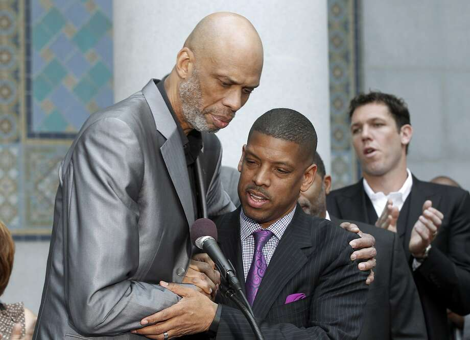 Hall of Famer Kareem Abdul-Jabbar and Sacramento Mayor Kevin Johnson embrace at a news conference after the announcement of Donald Sterling's banishment. Photo: Associated Press