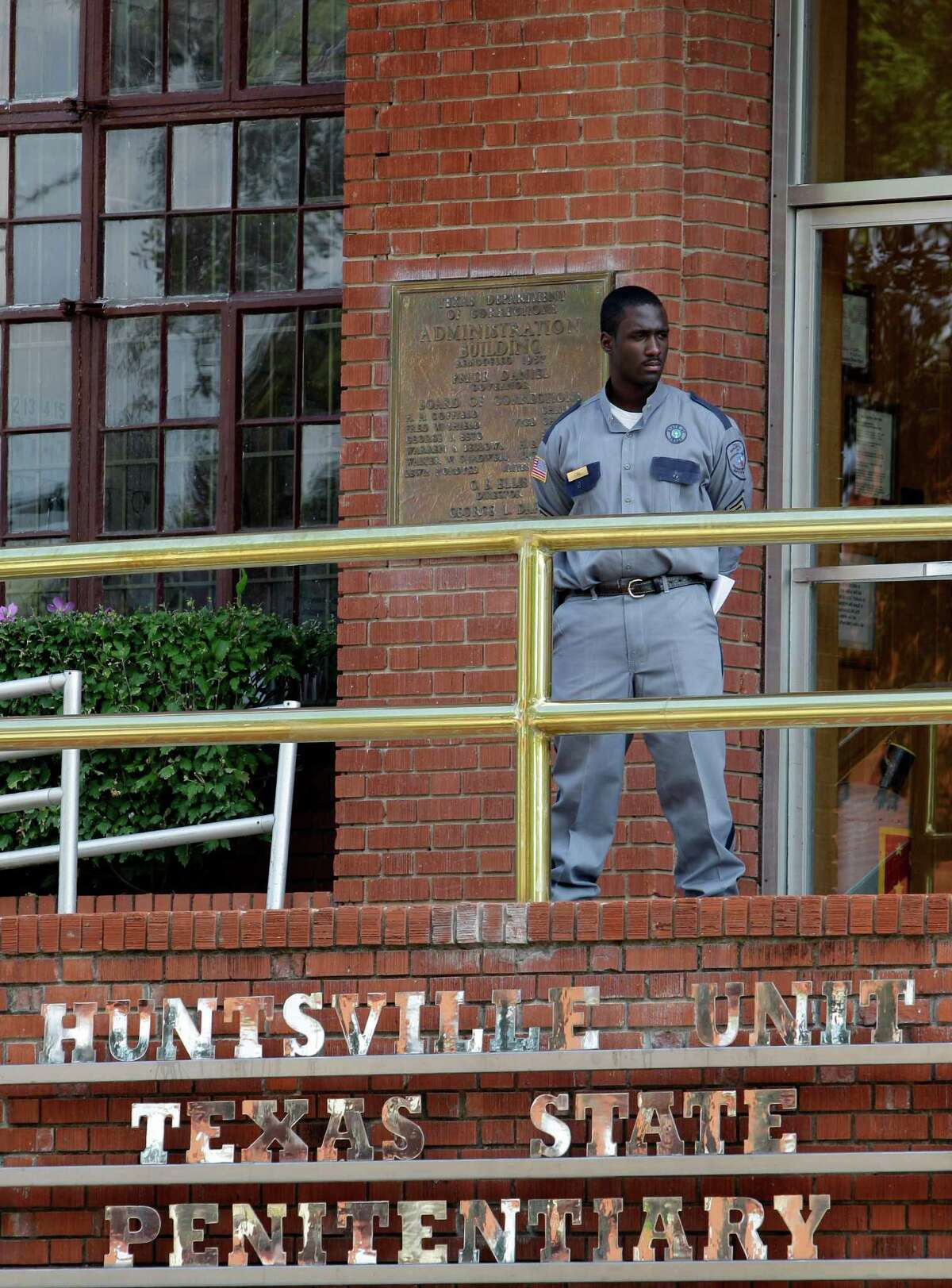 In this Sept. 21, 2011 file photo, a corrections officer keeps watch outside the Texas Department of Criminal Justice Huntsville Unit in Huntsville, Texas.