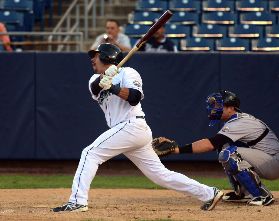 A triple here by Bluefish's shortstop Juan Martinez cleared three runs for the team, during opening night double-header baseball action against the Sugarland Skeeters at the Ballpark at Harbor Yard in Bridgeport, Conn. on Thursday May 1, 2014. Photo: Christian Abraham / Connecticut Post