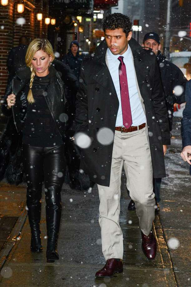 "Russell Wilson and his wife, Ashton Meem, enter the ""Late Show With David Letterman"" taping at the Ed Sullivan Theater on February 3, 2014, in New York City -- the day after his Seahawks won Super Bowl XLVIII. Photo: Ray Tamarra, Ray Tamarra/WireImage / 2014 Ray Tamarra"