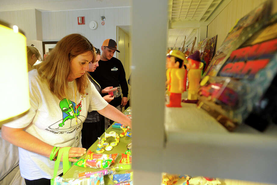 Kerstin Miller, of Novato, Calif., shops one of the rooms selling collectible PEZ dispensers during the 16th annual Northeast PEZ Collectors Gathering at the Sheraton Stamford Hotel in Stamford, Conn., on Thursday, May 1, 2014. Photo: Jason Rearick / Stamford Advocate