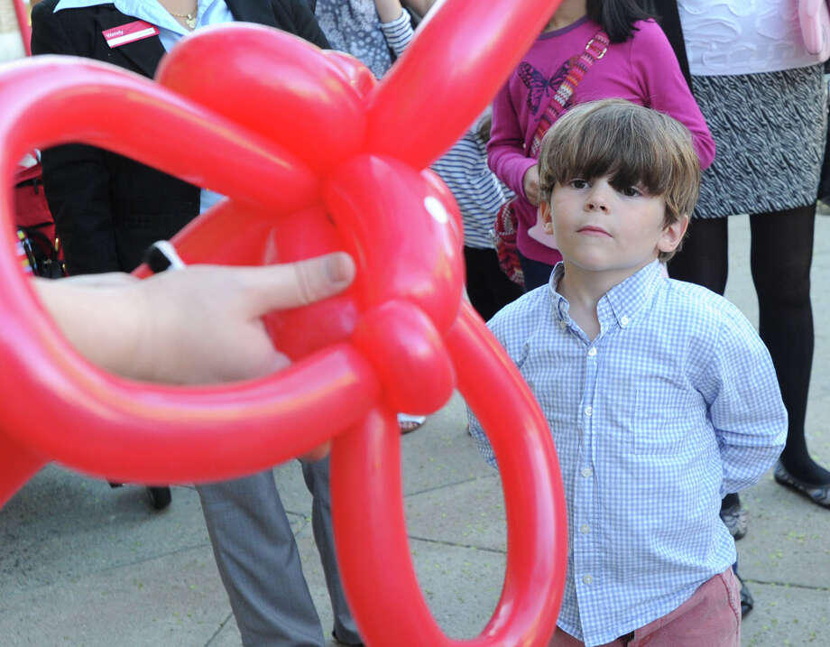 Parker Young gets a look at a balloon animal during the Greenwich Arts Council's annual Art to the Avenue event on Greenwich Avenue, Thursday night, May 1, 2014. More than 150 artists will display artworks at local stores and businesses through May 26. All art is for sale. A portion of sales is tax deductible and benefits the Greenwich Arts Council. For a map of artists and their locations, visit www.greenwich arts.org Photo: Bob Luckey / Greenwich Time