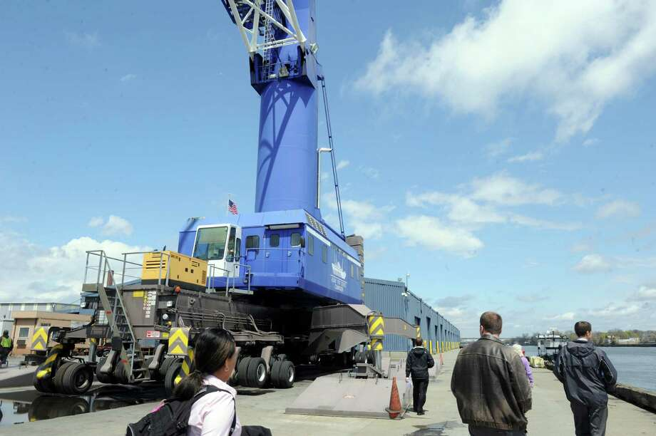 Participants in the Port of Albany Industry Day take a tour past the Port's Liebherr mobile harbor crane Thursday, May 1, 2014, in Albany, N.Y. (Michael P. Farrell/Times Union) Photo: Michael P. Farrell / 00026663A
