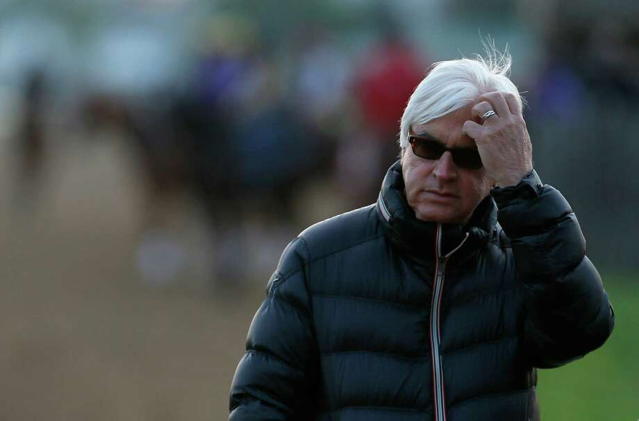 LOUISVILLE, KY - MAY 01:  Bob Baffert, trainer of Kentucky Derby contenders Hoppertunity and Chitu, watches track activity during early morning workouts at Churchill Downs on May 1, 2014 in Louisville, Kentucky.  (Photo by Kevin C. Cox/Getty Images) ORG XMIT: 486540241 Photo: Kevin C. Cox / 2014 Getty Images