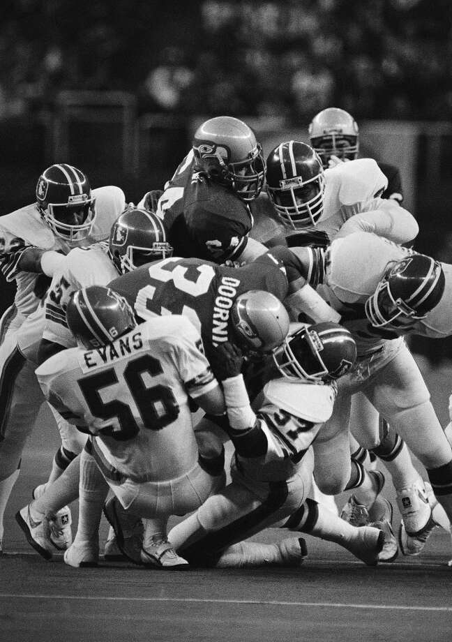 1980: Ron EssinkTenth round, 265th-overall pick | Position: Offensive tackle | College: Grand Valley StateEssink (pictured No. 64) scored one touchdown on one reception his rookie year lining up as a tight end, but he spent his six years with the Seahawks mainly as their starting left tackle. He started 70 of his 83 game appearances -- all with the Hawks -- and was an integral member of the 1983 team that made it to the AFC Championship Game. Essink retired after 1985. Photo: Dave Ekren, AP