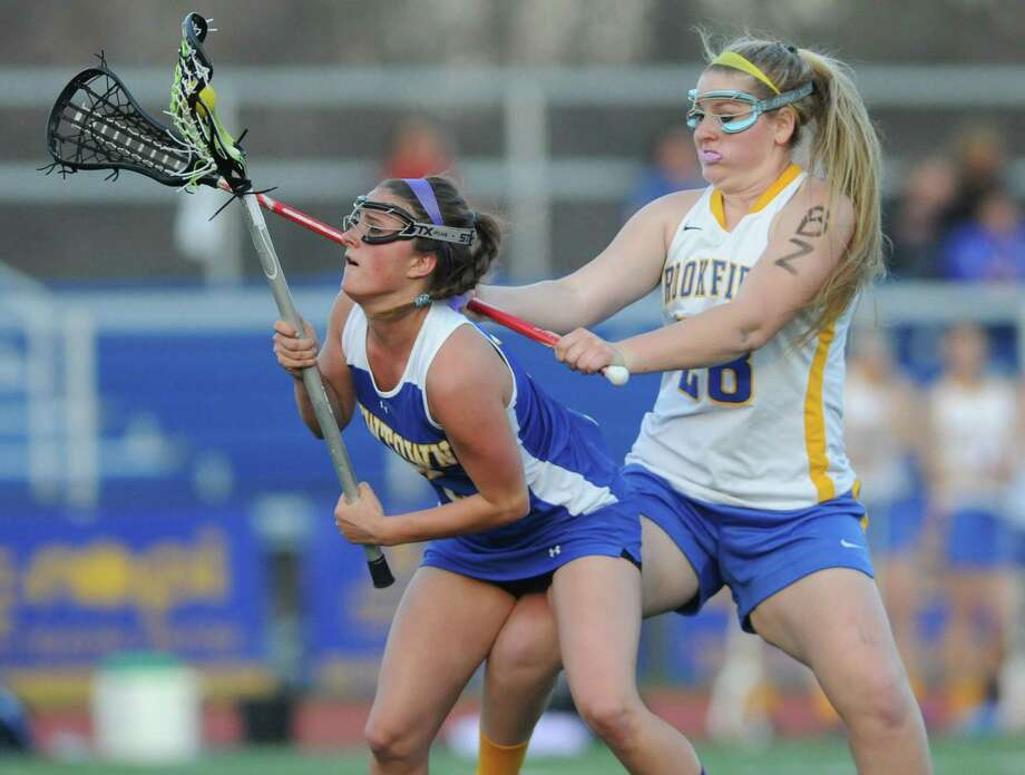 Newtown's Carley Ferris, left, gets fouled by Brookfield's Stephanie Hunt in Brookfield's 9-7 win over Newtown in the high school girls lacrosse game at Brookfield High School in Brookfield, Conn. Thursday, May 1, 2014. Photo: Tyler Sizemore / The News-Times
