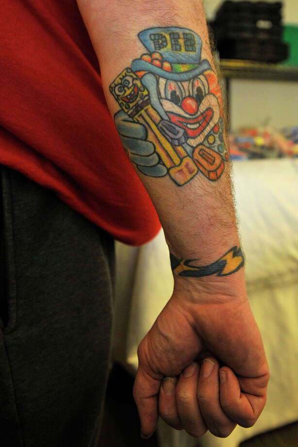 Chris Catlin, of Horton, Mich., shows off his tattoo featuring a clown, the PEZ mascot, during the 16th annual Northeast PEZ Collectors Gathering at the Sheraton Stamford Hotel in Stamford, Conn., on Thursday, May 1, 2014. Photo: Jason Rearick / Stamford Advocate