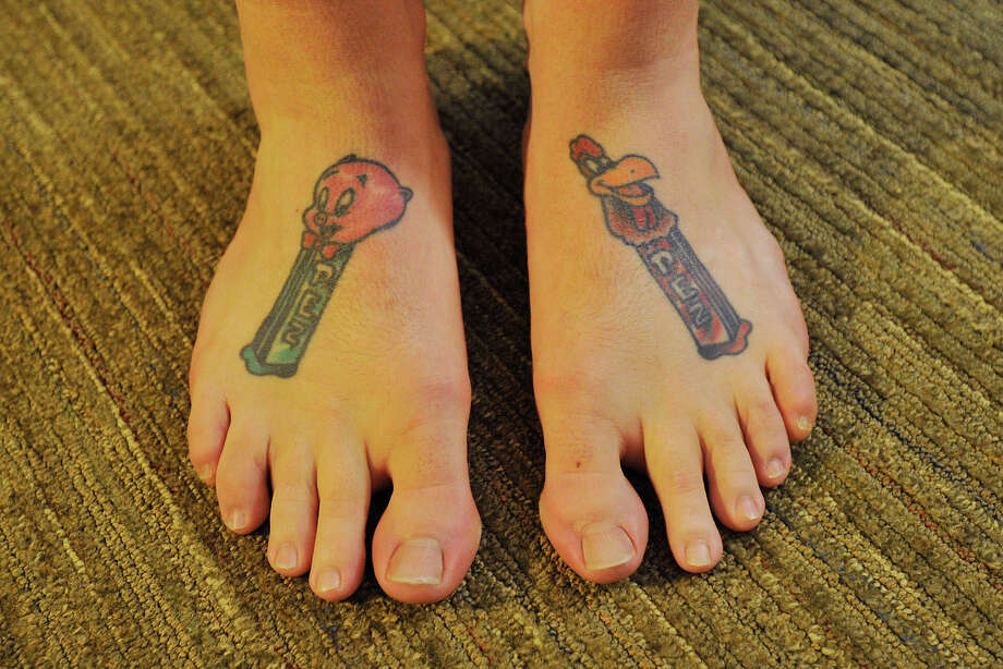 Aaron Lamay, of Newport, R.I., shows off his PEZ tattoos on the tops of his feet during the 16th annual Northeast PEZ Collectors Gathering at the Sheraton Stamford Hotel in Stamford, Conn., on Thursday, May 1, 2014. Lamay has been a PEZ collector for 24 years. Photo: Jason Rearick / Stamford Advocate