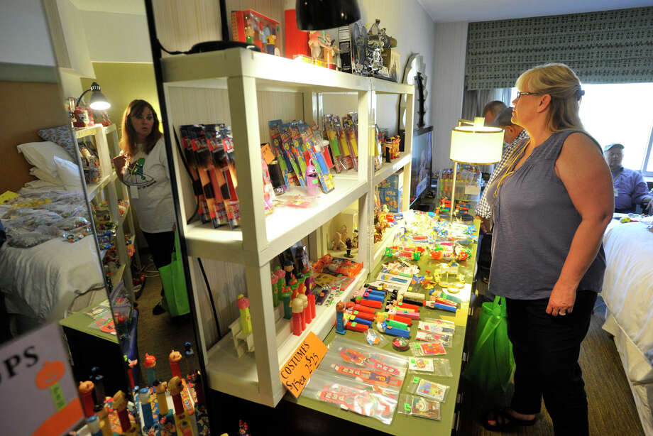 Barbara Goodsell, of Chandler, Ariz., shops for PEZ collectibles during the 16th annual Northeast PEZ Collectors Gathering at the Sheraton Stamford Hotel in Stamford, Conn., on Thursday, May 1, 2014. Photo: Jason Rearick / Stamford Advocate