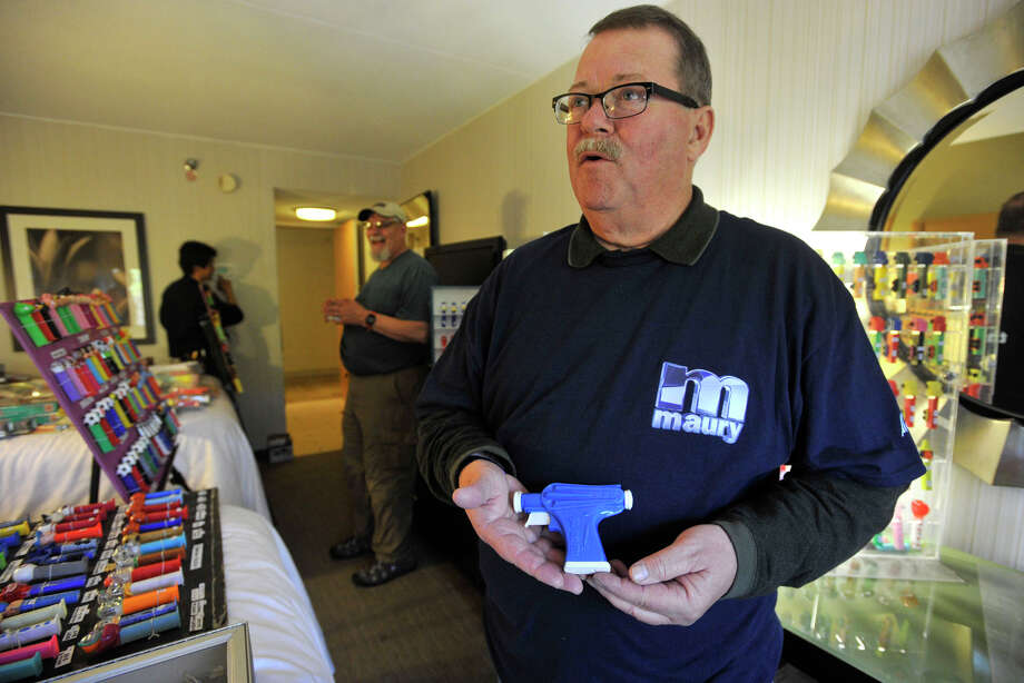 Dan McFadden, of Warminster, Pa., shows off the rare PEZ gun he is purchasing during the 16th annual Northeast PEZ Collectors Gathering at the Sheraton Stamford Hotel in Stamford, Conn., on Thursday, May 1, 2014. Photo: Jason Rearick / Stamford Advocate