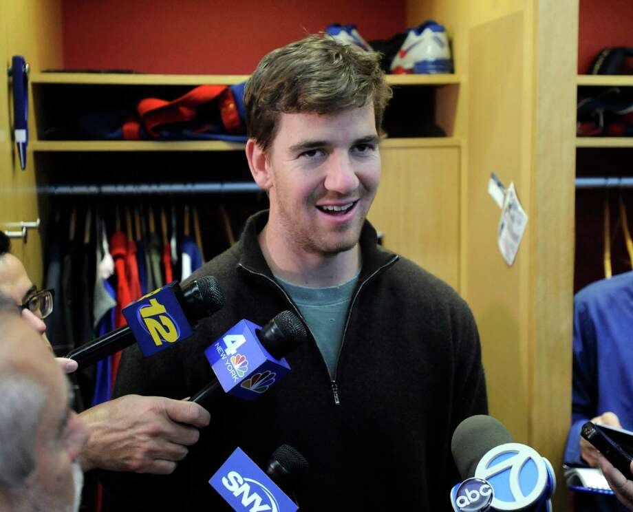 New York Giants quarterback Eli Manning speaks to the media Monday, Dec. 30, 2013, in East Rutherford, N.J. after the Giants season ended with a 7-9 record. (AP Photo/Bill Kostroun) ORG XMIT: NJBK107 Photo: Bill Kostroun / FR51951 AP