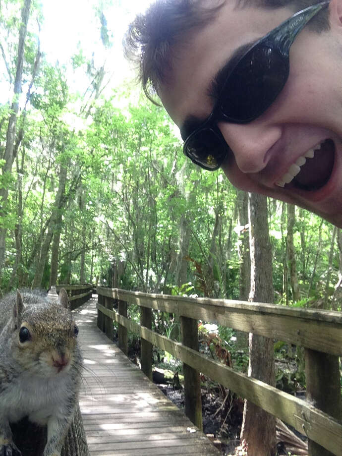 Brian Genest says taking a selfie with a squirrel was working out just fine until the animal was frightened by the flash and the sound from his cellphone. Photo: HONS / Brian Genest