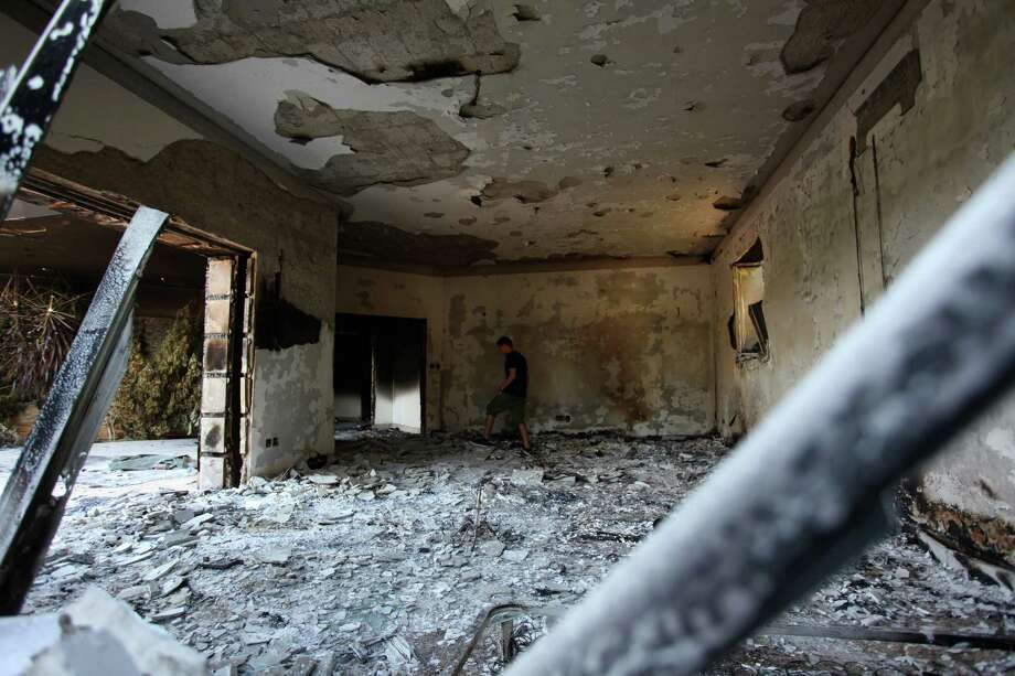 FILE - This Sept. 13, 2012 file photo shows a man walking in the rubble of the damaged U.S. consulate, after an attack that killed four Americans, including Ambassador Chris Stevens on the night of Tuesday, Sept. 11, 2012, in Benghazi, Libya. A retired general who was in the U.S. military's operation center during the 2012 attack on the diplomatic outpost in Benghazi, Libya, said Thursday that Washington should have done more to respond during the battle. (AP photo/Mohammad Hannon, File) Photo: Mohammad Hannon, STR / AP
