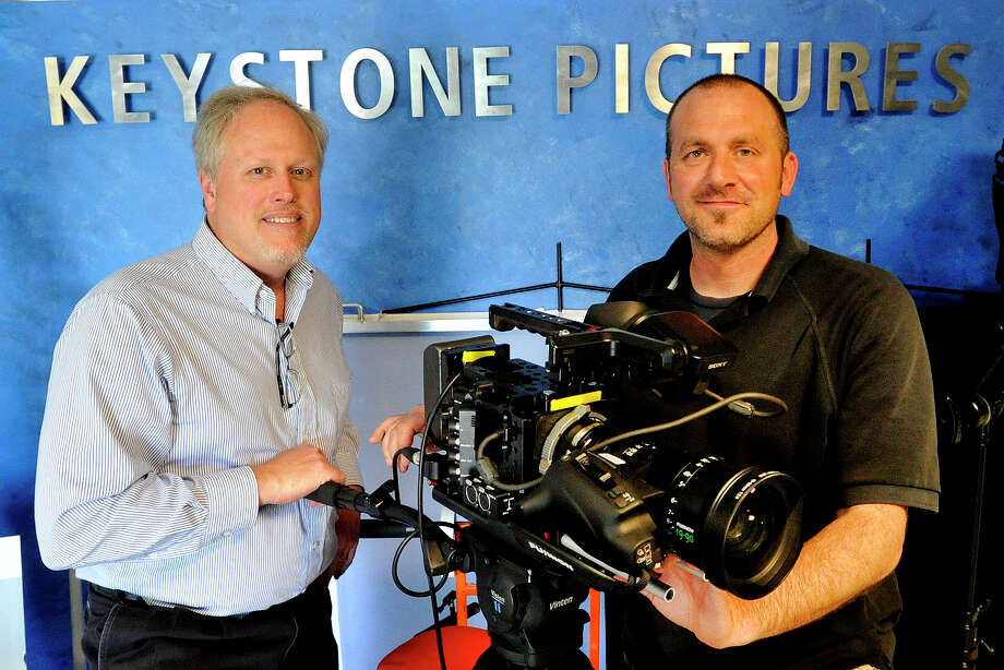 Partners Darryl Rode, left, and Rob Marish pose for a photograph during the open house of the new Keystone Pictures in Stamford, Conn., on Thursday, May 1, 2014. Keystone Pictures, a Philadelpia based TV production services and rental house, has expanded into its new location on Summer Street in Stamford. Photo: Jason Rearick / Stamford Advocate
