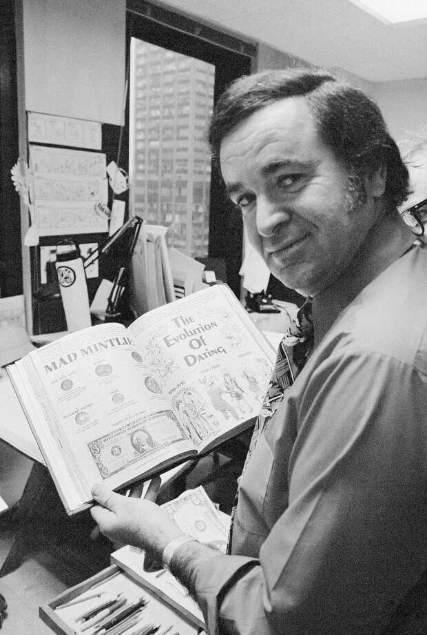 "FILE - In this 1972 file photo, ""Mad"" magazine editor Al Feldstein works on page layout in his office at the magazine's New York headquarters. Feldstein, whose 28 years at the helm of Mad transformed the satirical magazine into a pop culture institution, died Tuesday, April 29, 2014. He was 88. (AP Photo/Jerry Mosey, File) ORG XMIT: NY130 Photo: Jerry Mosey / AP"