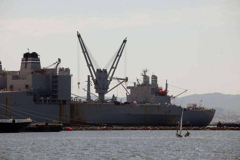A sailor rides by docked naval ships at Alameda Point in Alameda, Calif. on Thursday, May 1, 2014. Photo: Tim Hussin, Special To The Chronicle